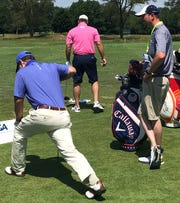 Tom Watson (left) and fill-in caddie Greg Helmkamp (right) on the practice tee at this week's U.S. Senior Open