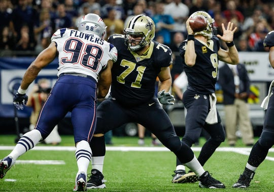 New Orleans Saints offensive tackle Ryan Ramczyk (71) blocks New England Patriots defensive end Trey Flowers.