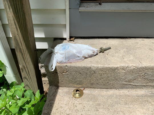 A bag filled with either human or animal waste sits on the steps of a home in the 5700 block of Rawles Ave. Alexis Scott said the bag was there when she moved in and her landlord has not removed it.