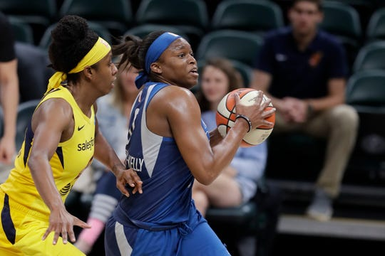 Minnesota Lynx's Karima Christmas-Kelly (0) drives to the basket against Indiana Fever's Shenise Johnson during the first half of a WNBA basketball game, Tuesday, June 25, 2019, in Indianapolis.