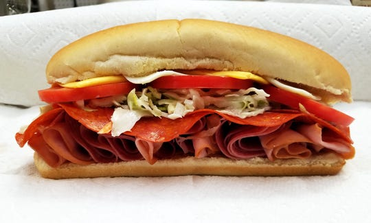 The American Hoagie hugs Virginia ham, salami, pepperoni, a lettuce/slaw mixture, freshly made special sauce, tomatoes and American and jalapeno cheeses at the 2019 Indiana State Fair.