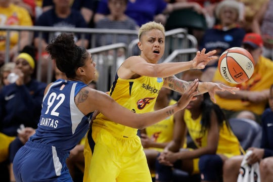 Indiana Fever's Candice Dupree (4) passes against Minnesota Lynx's Damiris Dantas (92) during the first half of a WNBA basketball game, Tuesday, June 25, 2019, in Indianapolis.