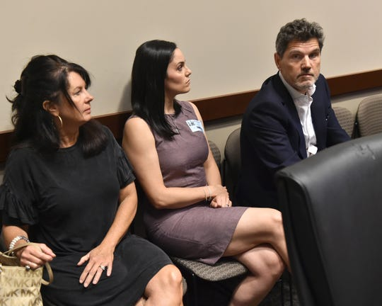 (Left to right) Miss. Sen. Angela Burks Hill, Lauren Hierlmeier and her uncle, attorney John Lauro, listen as the State and School Employees Health Insurance Management Board declines to intervene in the case of Hierlmeier's husband, Bryan. Dr. Bryan Hierlmeier of UMMC was denied coverage for a recommended cancer treatment by Blue Cross & Blue Shield of Mississippi.  Wednesday, June 26, 2019.