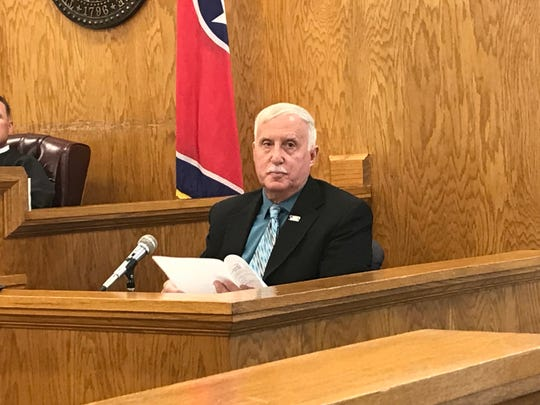 Mike Brown, a former Grundy County Sheriff's Office deputy, reads through a report during his testimony Wednesday, June 29, 2019, in Grundy County Circuit Court. Brown discovered the body of Malcolm Burrows the night of the killing in January 2006. He says he believes Adam Braseel was wrongly convicted of killing Burrows.