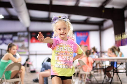 "Chloe Floyd, 8, is attending the recreational cheer camp at Twisters Cheer and Tumbling on June 25. Chloe is at the gym four to five times a week and would be there every day if she could. ""She is learning one man college style stunts and has made so many friends here. After one practice she took seven girls home for a sleepover,"" said Twisters owner Rebekah Chait."