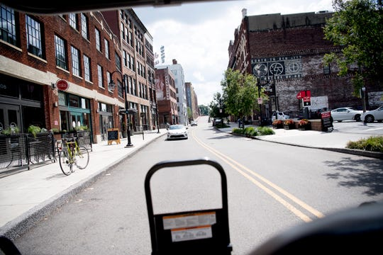 A view looking down Jackson Avenue from a Joyride golf cart in Old City in Knoxville, Tennessee on Tuesday, June 25, 2019. Joyride is offering six new tours including a brew tour and a mural Instagram tour.
