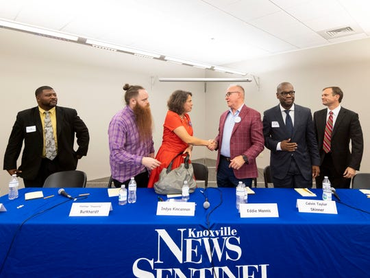 City of Knoxville mayoral candidates, from left, Michael Andrews, Fletcher Burkhardt, Indya Kincannon, Eddie Mannis, Calvin Skinner and Marshall Stair shake hands after a forum at the News Sentinel on Tuesday, June 25, 2019.