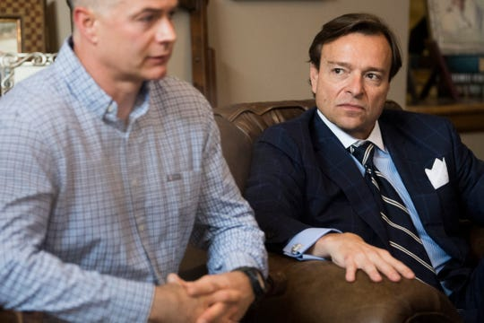 Attorney Gregory P. Isaacs listens as Josh Munday speaks about the death of his 15-year-old son Zach, at Isaacs' office on Gay Street Wednesday, June 26, 2019.
