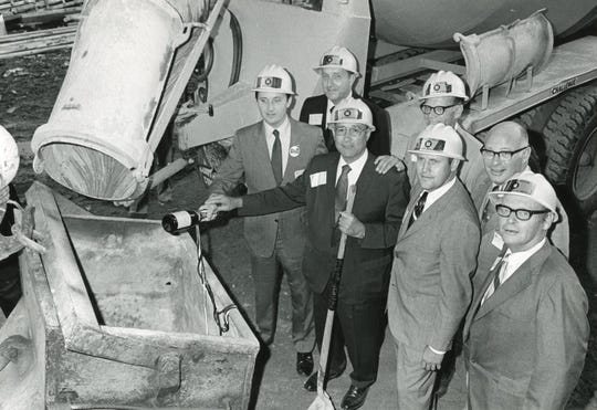 Christening the construction site of the Hyatt Regency with a bottle of champagne, September 1971.