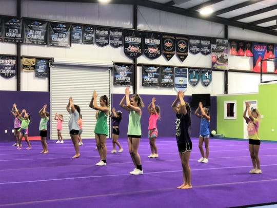 Former Twisters Cheer and Tumbling coach Mallory Murtle of Fort Worth, Texas, leads a camp focused on sideline cheer on June 25 at the new Twisters facility.