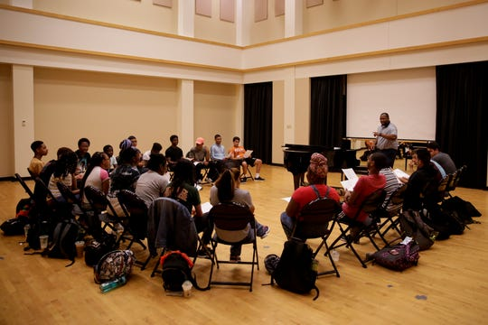 "James Dekle takes a group of high school seniors through a music workshop as they sing ""I will die for you"" by Prince inside the Purdue Black Cultural Center, Wednesday, June 26, 2019 in West Lafayette. The BCC is celebrating its 50th anniversary this year."