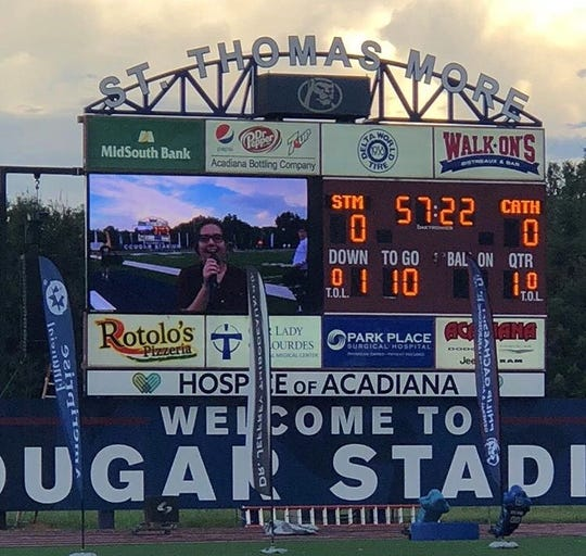 Carlin Sekhani-Matthews, a rising senior at St. Thomas More Catholic High School, reports from the sidelines and appears on the stadium's giant TV screen during football games.