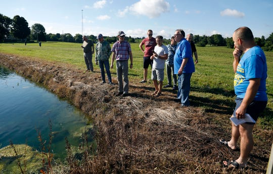 Don Maloney, second from right, talks to a group of a Polish farmers and academics through Greg Lecki, third from left, Tuesday, June 25, 2019, at Don's Prawns & More in Richland Township. The group was visiting Maloney's freshwater prawn farm as part of a multi-state tour of agricultural operations in U.S. Lecki, program coordinator for Ohio State University's Ohio International Intern Program, set up the trip.