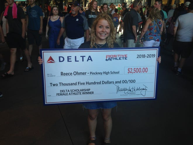 Pinckney golfer Reece Ohmer won a $2,500 college scholarship as the Michigan female winner of the Positive Athlete award at Comerica Park on Tuesday, June 25, 2019.