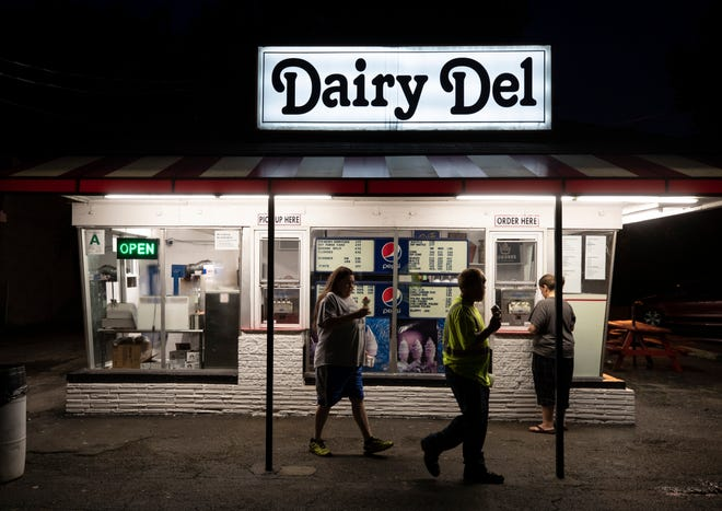 Closing time at the Dairy Del on Seventh Street and the. last few customers walk away with their ice creams. The shop has been in business since 1951. June 25, 2019.