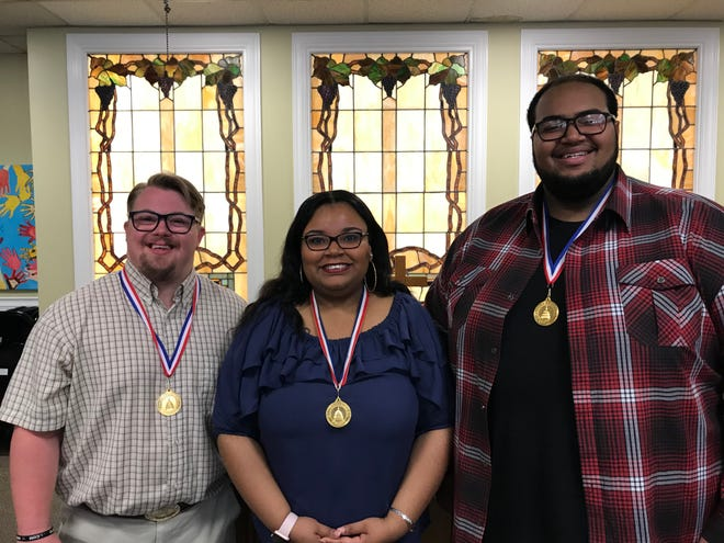 Lucas Fortwengler (left), Tierra Beard (center) and Demetrius Gunn pose with their U.S. Congressional Gold Medals for Youth. June 26, 2019