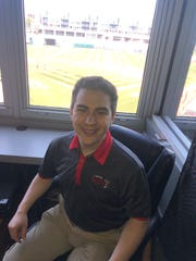 Lansing Lugnuts broadcaster Jesse Goldberg-Strassler is pictured in his booth at Cooley Law School Stadium on June, 25, 2019.