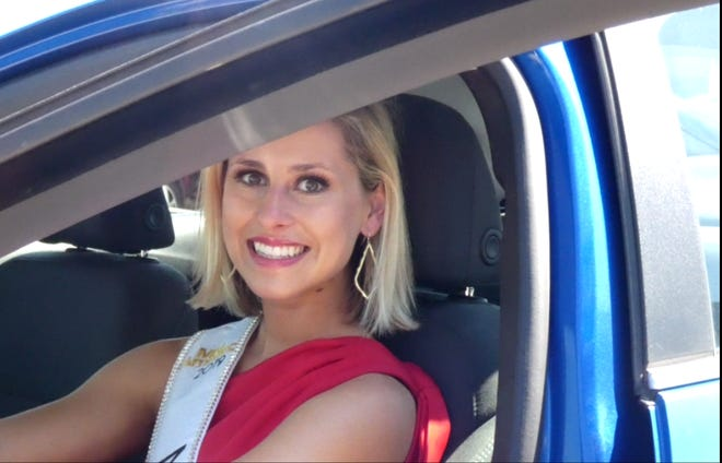 Miss Ohio Caroline Grace Williams picks up her Chevy Cruze at Graham Automall Wednesday. Graham Automall  provides a free one-year lease for the vehicle to the Miss Ohio Scholarship Program for the winner to drive as she crisscrosses the state during her reign. Williams, from Cincinnati, was crowned June 16 at the Renaissance Theatre.