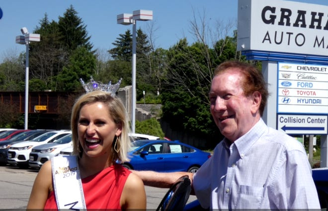 Miss Ohio Caroline Grace Williams picked up a Chevy Cruz Wednesday at Graham Automall. Graham Automall leases the car to the Miss Ohio Scholarship Program for the winner to drive across Ohio during her reign. At right is Doc Stumbo, Graham community relations manager.