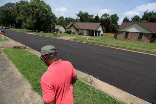 Larry Donald, a retiree from the Christine Gardens subdivision, walks down his street, in a neighborhood that has resisted a proposed 24-hour-a-day trucking terminal on 60 acres nearby.