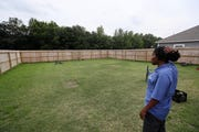 Jessica Wester looks off in the distance past the fence line of her new home, where across the street, Louisiana-based trucking company Saia is working on plans for a 24-hour-a-day trucking terminal projected to generate 1,500 trips per day.