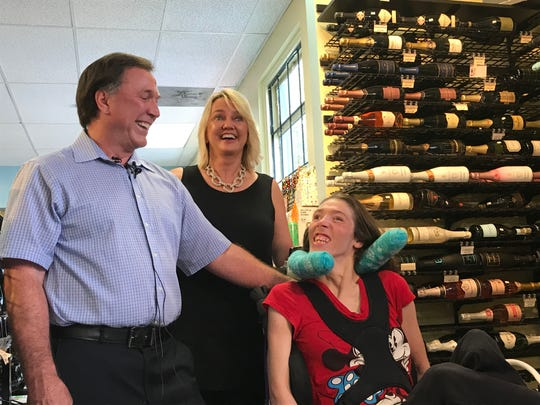 Doug and Mary Ketchum laugh with their daughter, Stacie.