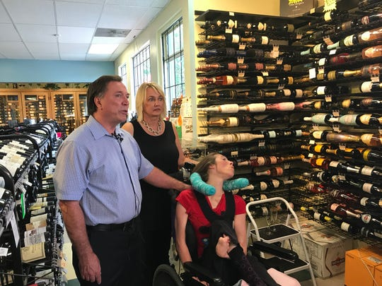 From left, Doug, Mary and Stacie Ketchum in Kimbrough Towers Fine Wines and Spirits on Wednesday, June 26. The Ketchums were the beneficiary of U.S. Supreme Court ruling that struck down a Tennessee law governing ownership of liquor stores.