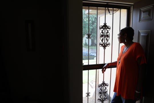 Proteon Paulk, 73, looks out the front door of her home, where across the street, on 60 acres behind her neighbors' homes, Louisiana-based trucking company Saia has plans to construct a 24-hour-a-day trucking terminal.