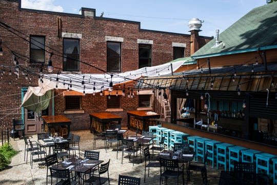 A look at the patio at The Second Line at 2144 Monroe. The patio features shade provided by a parachute, a outdoor bar, and plenty of seating.