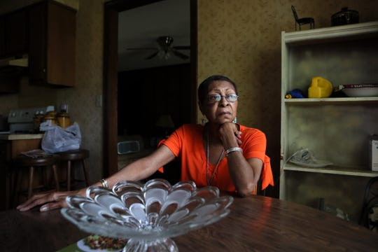 """Proteon Paulk, 73, sits in the kitchen of her home where she organized meetings with neighbors as they attempted to thwart the plans of Louisiana-based trucking company Saia to build a 24-hour-a-day trucking terminal. After a year-long battle where residents spoke out against the case and watched it fail to gain the approval from the Land Use Control Board on two separate occasions, the project was then approved by Memphis City Council. """"What this has done… it has broken our hearts, because we have no place to go,"""" said Paulk."""