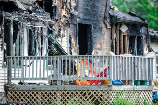 Some toys sit on the front porch of a house destroyed by fire Tuesday in Pickerel.