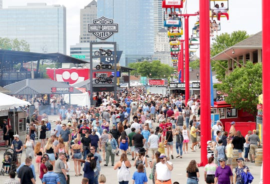 Crowds fill the concourse between stages at Summerfest in Milwaukee on Wednesday, June 26, 2019.