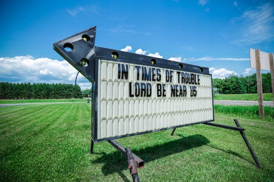 "A sign reading ""In times of trouble Lord be near us"" sits in front of St.  John Lutheran Church Wednesday, June 26, 2019, in Pickerel, Wis."