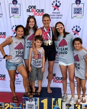 Mary Jo Augustine is pictured with her grandchildren after winning five swimming medals at the National Senior Games last week in Albuquerque, N.M. Pictured are: (from left) Joia Traver, Sydnee Trogdon, Slater Trogdon, Augustine, Sierra Trogdon and Peeka Traver.