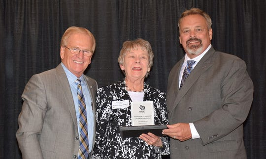 Frances Petty Sargent (center), pictured here with Mayor Dennis Tyler And Jeff Howe Of presenting sponsor Old National Bank, was the recipient of the Mayor's Arts Awards Lifetime Achievement Award in 2017. Sargent, who died in December 2017, was honored for her support of Ball State University's Owsley Museum of Art, Minnetrista, Cornerstone Center for the Arts and also the placement of public sculptures in the city.