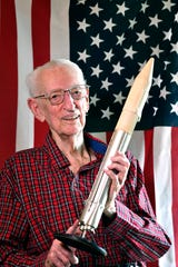 Rocket scientist J. Cary Nettles, 103, who helped man land on the moon, holds a model of a rocket in his Columbia, Tenn., home Friday, June 21, 2019.