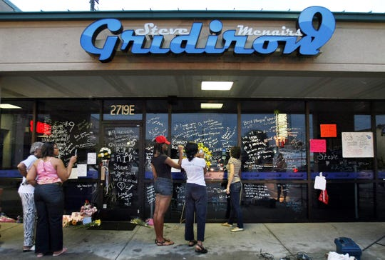 Fans visit Steve McNair's Gridiron9 restaurant on July 4, 2009, after learning of the former NFL quarterback's death.