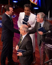 From left, state Rep. John Ray Clemmons, Mayor David Briley, retired Vanderbilt professor Carol Swain and At-Large council member John Cooper greet each other after a mayoral debate at Belmont University's McAfee Concert Hall on June 25, 2019.