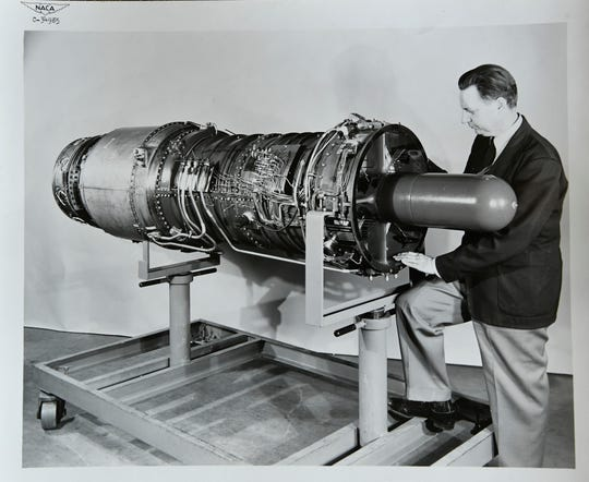 Rocket scientist J. Cary Nettles poses with an engine while working at the National Advisory Committee for Aeronautics. NACA later became NASA. Nettles retired from NASA in 1970 at 55 years old.