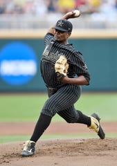 Vanderbilt pitcher Kumar Rocker (80) pitches against Michigan in the 2019 NCAA Men's College World Series Finals at TD Ameritrade Park  Tuesday, June 25, 2019, in Omaha, Neb.