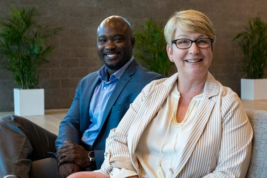 Carnell Elliott, left, co-site leaderand inside sales director, and Nikki Gibson, co-site leader andhuman resources consultant, sit in the lobby of Dell Technologies' One Dell Parkway campus in Nashville on Wednesday, June 26, 2019.