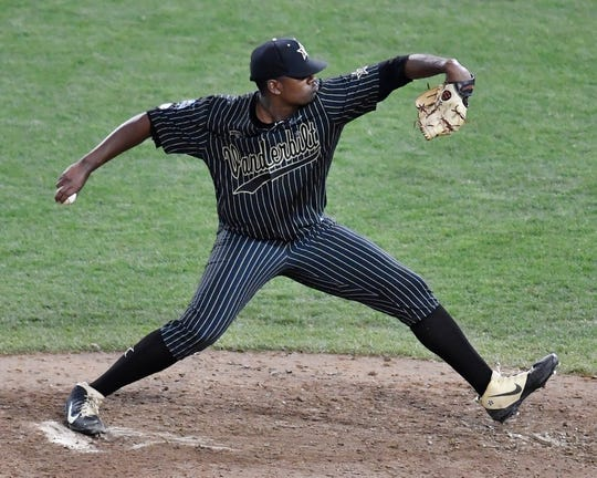 Vanderbilt pitcher Kumar Rocker (80) throws a pitch in the bottom of the seventh inning against Michigan in the 2019 NCAA Men's College World Series Finals at TD Ameritrade Park  Tuesday, June 25, 2019, in Omaha, Neb.