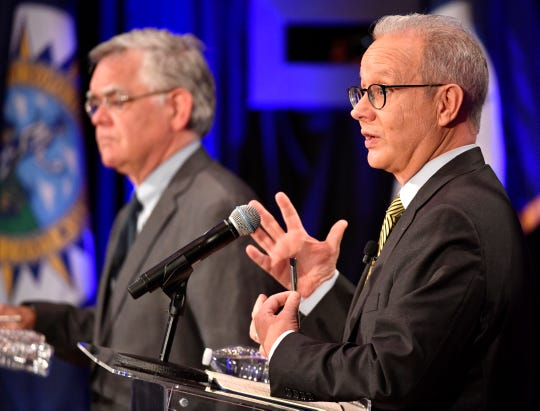Mayor David Briley speaks as At-Large Councilman John Cooper listens during a mayoral forum at McAfee Concert Hall on Belmont University's campus Tuesday, June 25, 2019.