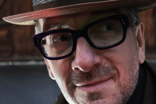 Say hello to the horn-rimmed and hatted master songwriter, Elvis Costello.