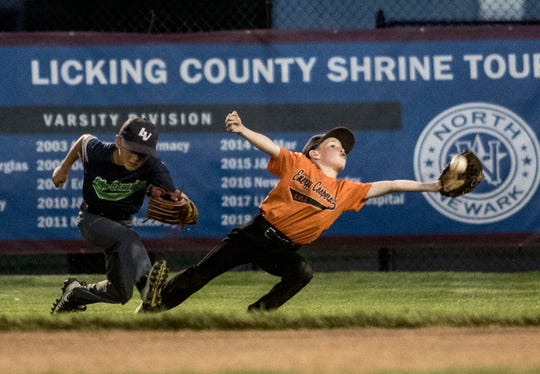 Licking Valley Energy Cooperative's Braidyn Wills reaches out to catch a fly ball in the final inning of the Licking County Shrine Farm Division championship. His team won the game, and the catch earned Wills the game ball.