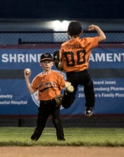 Brody Sforza jumps for joy after seeing his Energy Cooperative teammate, Braidyn Wills, had caught a fly ball in the final inning of the Shrine Farm Division championship.