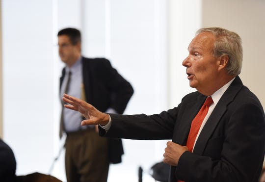 As attorney Charles Sciarra stands and listens, Ray Wiss, Hackensack's labor attorney, speaks to Judge Andrew Baron at the beginning of the hearing at the Administrative Law Court in Newark on 06/26/19.