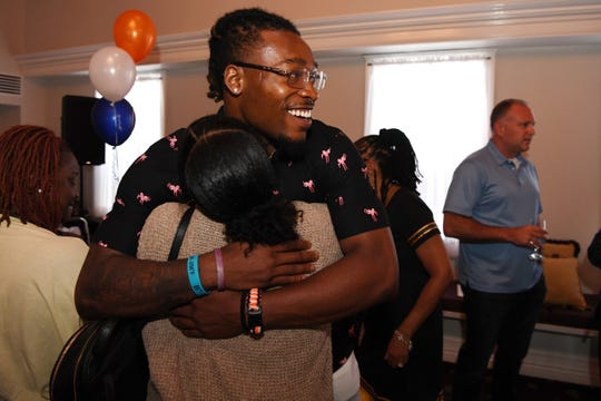 "The Team Winfree Youth Foundation hosts a ""sendoff party"" for Juwann Winfree, the Denver Broncos draft pick from Englewood (and Foundation CEO) on Wednesday, June 26, 2019. Juwann Winfree hugs Tanyah Ramos."