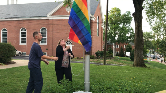 Mayor Dianne Didio raises the LGBTQ pride flag on June 25 for the first time in the borough's history.