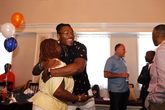 "The Team Winfree Youth Foundation hosts a ""sendoff party"" for Juwann Winfree, the Denver Broncos draft pick from Englewood (and Foundation CEO) on Wednesday, June 26, 2019. Juwann Winfree hugs Tamika Pressley."